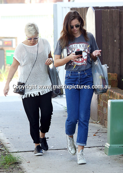 26 MARCH 2017 SYDNEY AUSTRALIA<br /> WWW.MATRIXPICTURES.COM.AU<br /> <br /> EXCLUSIVE PICTURES<br /> <br /> Jesinta Campbell pictured with her parents out for a walk in Rose Bay to get some groceries. <br /> <br /> Note: All editorial images subject to the following: For editorial use only. Additional clearance required for commercial, wireless, internet or promotional use.Images may not be altered or modified. Matrix Media Group makes no representations or warranties regarding names, trademarks or logos appearing in the images.