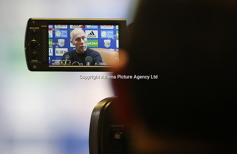 Through the lens of a video camera Swansea Citys head coach Bob Bradley answers questions from the press during the post match interview after the Premier League match between West Bromwich Albion and Swansea City at The Hawthorns, England, UK. Wednesday 14 December 2016