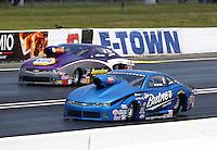 Jun 7, 2015; Englishtown, NJ, USA; NHRA pro stock driver Bo Butner (near) races alongside Vincent Nobile during the Summernationals at Old Bridge Township Raceway Park. Mandatory Credit: Mark J. Rebilas-