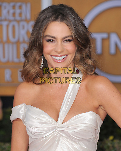 Sofia Vergara (wearing Donna Karan Atelier).Arrivals at the 19th Annual Screen Actors Guild Awards at the Shrine Auditorium in Los Angeles, California, USA..27th January 2013.SAG SAGs headshot portrait smiling white silk satin one strap off the shoulder .CAP/DVS.©DVS/Capital Pictures.