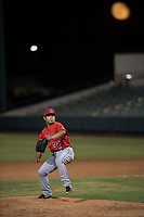 AZL Angels relief pitcher Kiber Arvelaez (31) delivers a pitch in front of a harvest moon during an Arizona League game against the AZL Indians 2 at Tempe Diablo Stadium on June 30, 2018 in Tempe, Arizona. The AZL Indians 2 defeated the AZL Angels by a score of 13-8. (Zachary Lucy/Four Seam Images)