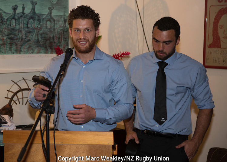 Tawera Kerr-Barlow (L) receives his official debutant's Maori All Blacks tie at the post-match function at the NZ High Commission. At right is Captain Charlie Ngatai. July 11, 2015. Photo: Marc Weakley