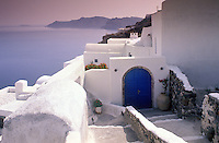 The shapely and colorful vernacular architecture of the Greek islands is evident in this view of walls and doors on Santorini.