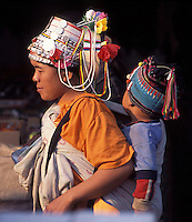 Laos, Luang Namtha Province, Muang Sing..Akha girl at the market with sibling..Photo by Kees Metselaar, 2003