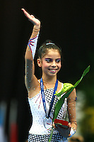 Filipa Siderova of Bulgaria smiles and waves during event final awards at 2006 Portimao World Cup of Rhythmic Gymnastics on September 10, 2006 at Portimao, Portugal.  (Photo by Tom Theobald)