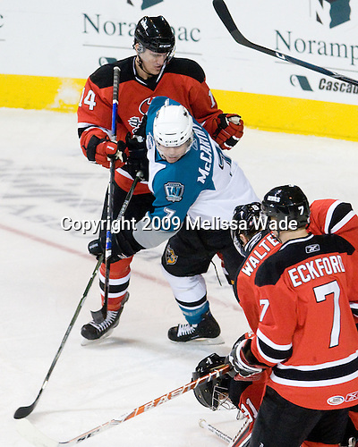 Nathan Perkovich (Lowell - 14), John McCarthy (Worcester - 7), Jeff Frazee (Lowell - 31) - The Lowell Devils defeated the Worcester Sharks 7-3 on Wednesday, November 11, 2009, at the DCU Center in Worcester, Massachusetts.