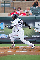 Estevan Florial (55) of the Pulaski Yankees follows through on his swing against the Elizabethton Twins at Calfee Park on July 25, 2016 in Pulaski, Virginia.  The Twins defeated the Yankees 6-1.  (Brian Westerholt/Four Seam Images)