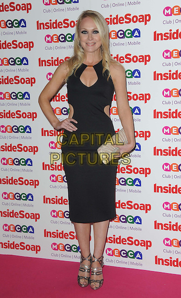 Michelle Hardwick <br /> Inside Soap Awards at Ministry Of Sound, London, England.<br /> 21st October 2013<br /> full length black dress silver sandals shoes clutch bag cut out away hand on hip<br /> CAP/DS<br /> &copy;Dudley Smith/Capital Pictures