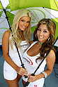 July 24, 2010 - Laguna Seca, USA - Two grid girls pose in the paddock prior the U.S. Grand Prix held on July 25, 2010. (Photo Andrew Northcott/Nippon News)