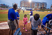 Sarah Tyndall checks out the souviener baseball bat she won with her brother during a game of waterballoon toss between innings at the Durham Bulls Athletic Park. The fun-filled family-friendly environment of the new stadium is a bit different from the wino-filled foul-mouthed stands of the early 1980's Durham Athletic Park.