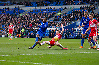 Junior Hoilett of Cardiff City shoots at goal under pressure from Grant Leadbitter of Middlesbrough during the Sky Bet Championship match between Cardiff City and Middlesbrough at the Cardiff City Stadium, Cardiff, Wales on 17 February 2018. Photo by Mark Hawkins / PRiME Media Images.