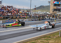 Jul 24, 2016; Morrison, CO, USA; NHRA top fuel driver Antron Brown (right) races alongside J.R. Todd during the Mile High Nationals at Bandimere Speedway. Mandatory Credit: Mark J. Rebilas-USA TODAY Sports