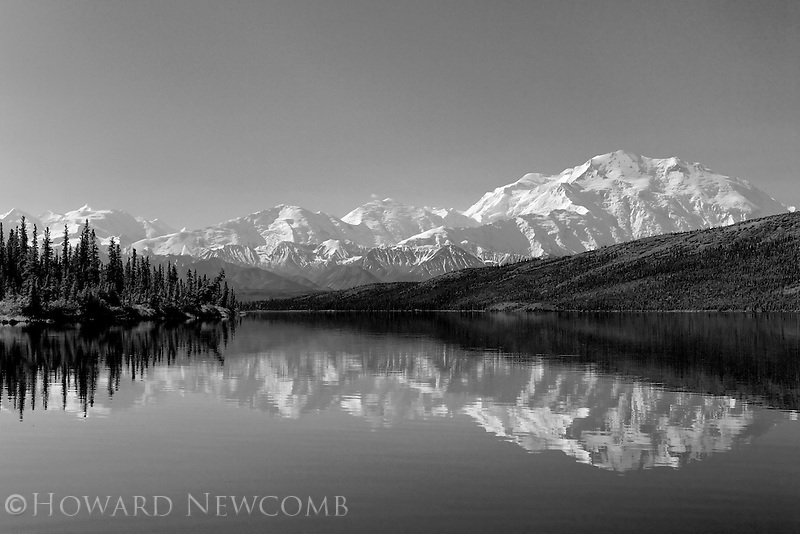A perfect mirror reflection of Mt. McKinley and the Alaska Range as seen from a canoe in the middle of Wonder Lake.  Clear and calm days like this are a rarity in Denali National Park.