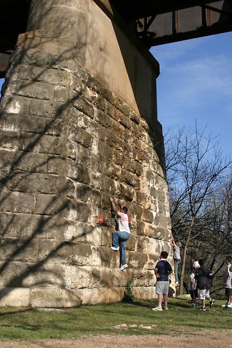 Austinites enjoy climbing up the pillars of the Union Pacific Railroad Bridge on town lake in austin.