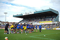 The Bath Rugby team huddle together during the pre-match warm-up. West Country Challenge Cup match, between Gloucester Rugby and Bath Rugby on September 13, 2015 at the Memorial Stadium in Bristol, England. Photo by: Patrick Khachfe / Onside Images