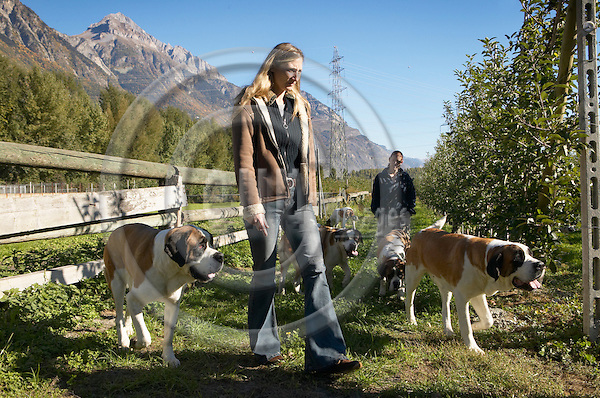 """MARTIGNY, SWITZERLAND 10. OCTOBER 2005 --    Fondation Barry du Grand-St-Bernard. The Saint Bernard dogs winter refugee down the valley of the St-Bernard pass. Jasmine Abagarde-Gaulle, manager of the Barry-Foundation (left) and an assisten with the dogs -- PHOTO: CHRISTIAN T. JOERGENSEN / EUP & IMAGES....This image is delivered according to terms set out in """"Terms - Prices & Terms"""". (Please see www.eup-images.com for more details)"""