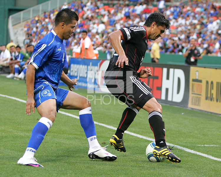 Jaime Moreno #99 of D.C. United  shields the ball from Jose Henriquez #4 of El Salvador during an international charity match at RFK Stadium, on June 19 2010 in Washington DC. D.C. United won 1-0.