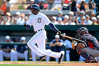 Detroit Tigers outfielder Austin Jackson #14 at bat in front of Gerald Laird #11 during a Spring Training game against the Atlanta Braves at Joker Marchant Stadium on February 27, 2013 in Lakeland, Florida.  Atlanta defeated Detroit 5-3.  (Mike Janes/Four Seam Images)