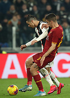 Calcio, Coppa Italia round 8 : Juventus - AS Roma, Turin, Allianz Stadium, January 22, 2020.<br /> Juventus' Cristiano Ronaldo (l) in action with Roma's Gianluca Mancini (r) during the Italian Cup football match between Juventus and Roma at the Allianz stadium in Turin, January 22, 2020.<br /> UPDATE IMAGES PRESS/Isabella Bonotto
