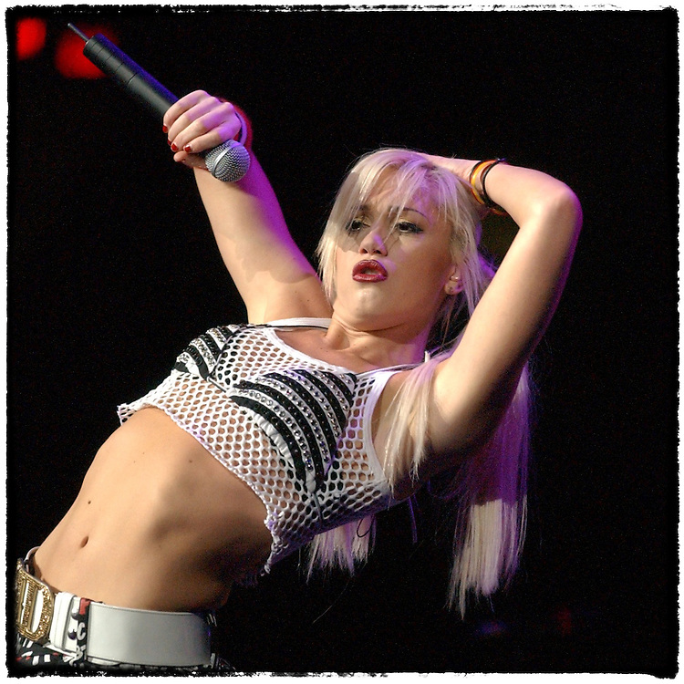 """No Doubt's Gwen Stefani opens for U2 in support of their Elevation tour performing """"Just a Girl"""" November 23, 2001"""