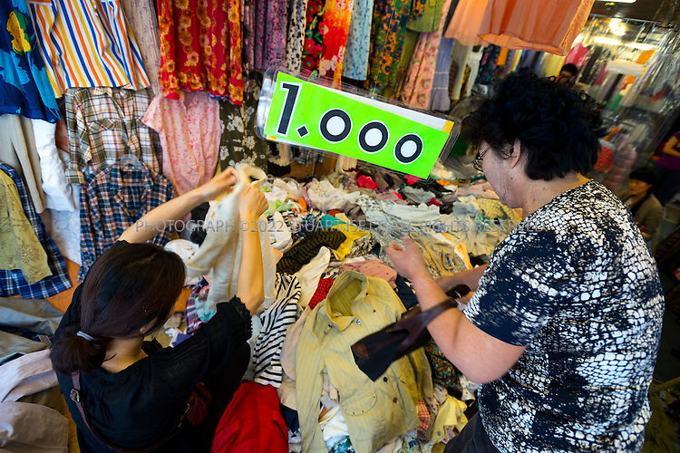 9/2/2013--Busan, South Korea<br /> Discount, 1000 won, second vclothing on sale in the Gukje market in Busan (Pusan).<br /> <br /> Photograph by Stuart Isett