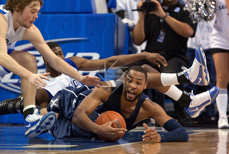 February 24,  2010                Xavier forward/center Jason Love (31) grabs the loose ball as Saint Louis guard Kyle Cassity (23) runs in from the left in the first half.    Behind the two is Saint Louis teammate Willie Reed (33).  The St. Louis University Billikens hosted the Xavier University Musketeers on Wednesday February 24, 2010 at the Chaifetz Arena, located on the campus of St. Louis University near downtown St. Louis.  Xavier ended Saint Louis' six-game winning streak, with a final score of 73-71.