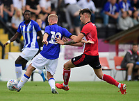 Sheffield Wednesday's Barry Bannan under pressure from Lincoln City's Ellis Chapman<br /> <br /> Photographer Chris Vaughan/CameraSport<br /> <br /> Football Pre-Season Friendly - Lincoln City v Sheffield Wednesday - Saturday July 13th 2019 - Sincil Bank - Lincoln<br /> <br /> World Copyright © 2019 CameraSport. All rights reserved. 43 Linden Ave. Countesthorpe. Leicester. England. LE8 5PG - Tel: +44 (0) 116 277 4147 - admin@camerasport.com - www.camerasport.com