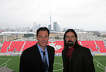 28 April 2007: HDNet play by play announcer Glenn Davis (l) and color commentator Marcelo Balboa (r) with a view of the East Stand and downtown Toronto behind him. Major League Soccer expansion team Toronto FC lost 1-0 to the Kansas City Wizards in the inaugural game at BMO Field in Toronto, Ontario, Canada, the first MLS game played outside of the United States.