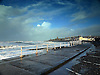 After the Storm on Aberystwyth Promenade with debris thrown up by the monster waves causing damage and floods.<br />