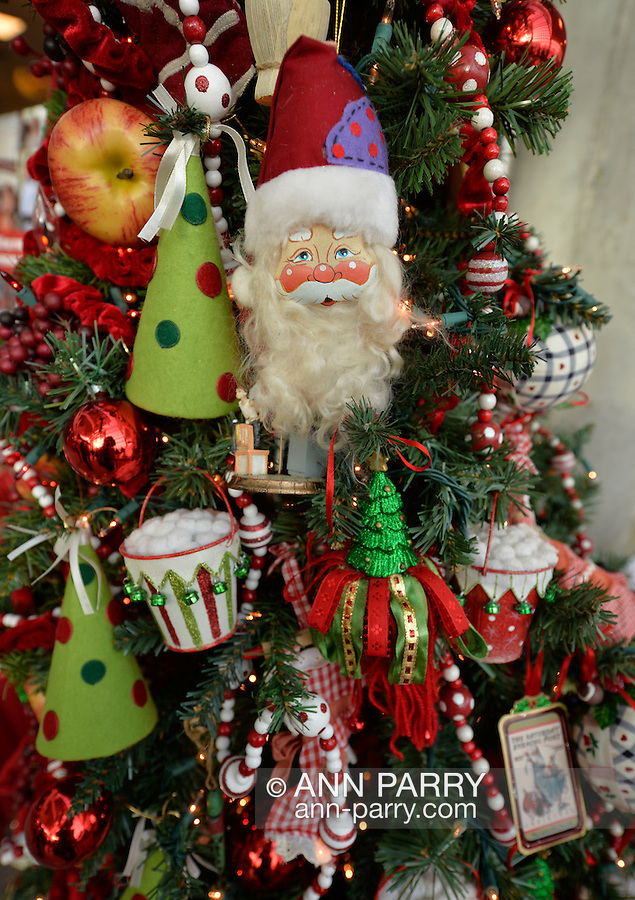 Garden City, New York, USA. November 30, 2013. The Winter holiday Festival of Trees includes displays of designer decorated trees available for sale, including this traditional one, and was held at Cradle of Aviation Museum during Thanksgiving weekend, with proceeds benefiting UCPN United Cerebral Palsy Association of Nassau County, Long Island.