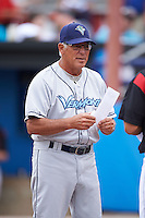 Vermont Lake Monsters manager Rick Magnante (7) during the lineup exchange before a game against the Batavia Muckdogs on July 12, 2013 at Dwyer Stadium in Batavia, New York.  Batavia defeated Vermont 4-2.  (Mike Janes/Four Seam Images)