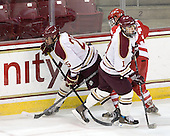 Anthony Cusano (BC - 25), Cody King (BC - 10), Steve Jordan (BU - 23) - The Boston College Eagles defeated the visiting Boston University Terriers 6-2 in ACHA play on Sunday, December 4, 2011, at Kelley Rink in Conte Forum in Chestnut Hill, Massachusetts.