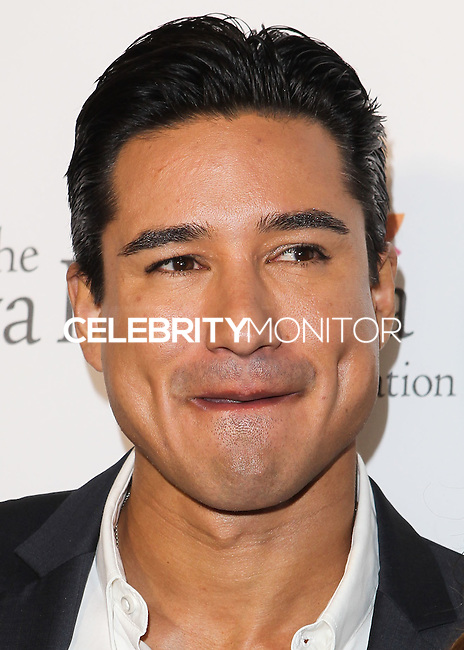HOLLYWOOD, LOS ANGELES, CA, USA - OCTOBER 09: Mario Lopez arrives at the Eva Longoria Foundation Dinner held at Beso Restaurant on October 9, 2014 in Hollywood, Los Angeles, California, United States. (Photo by Celebrity Monitor)