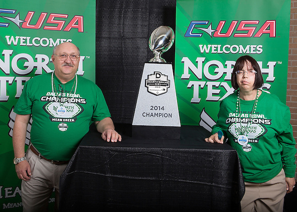 DENTON, TX  JANUARY 25: Fans pose in front of the 2014 Heart of Dallas Bowl trophy at the Super Pit - North Texas Coliseum in Denton on January 25, 2014 in Denton, TX. Photo by Rick Yeatts Photography / Matt Garnett