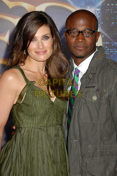 "IDINA MENZEL & TAYE DIGGS.""Enchanted"" Los Angeles Premiere at the El Capitan Theatre, Hollywood, California, USA..November 17th, 2007.half length green dress grey gray jacket glasses .CAP/ADM/BP.©Byron Purvis/AdMedia/Capital Pictures."
