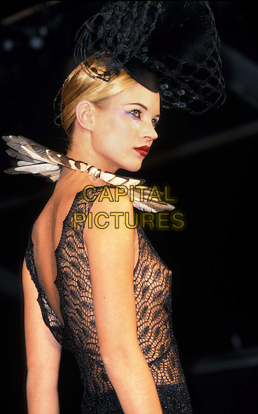 KATE MOSS..ref:2264..sales@capitalpictures.com..www.capitalpictures.com..©Capital Pictures..posing, catwalk, black lace, see through, see thru, dramatic make-up, black lace hat, backless top, feather collar
