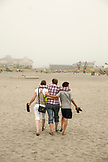 USA, Washington State, Long Beach Peninsula, family walks on the beach at the International Kite Festival