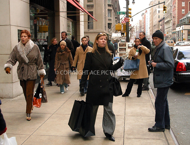 "It looks as if chilly, windy Monday is a waste of time for famed shutterbug Bill Cunningham, who runs his regular fashion feature, ""On the Street,"" in The New York Times. Without much luck Mr. Cunningham trying to make the most out of boring coats, purses, shopping bags, hats, scarves seen on Madison Avenue just outside Barney's New York. New York, December 23, 2002. Please byline: Alecsey Boldeskul/NY Photo Press.   ..*PAY-PER-USE*      ....NY Photo Press:  ..phone (646) 267-6913;   ..e-mail: info@nyphotopress.com"