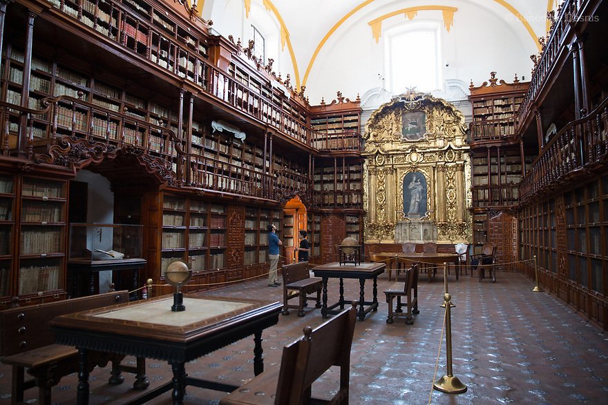 TheBiblioteca Palafoxiana library in Puebla, Mexico on April 22, 2017. Founded in 1646, it was the first public library in colonial Mexico, and is sometimes considered the first in the Americas.It has more than 45,000 books and manuscripts, ranging from the 15th to the 20th century. Most books and manuscripts ofthe Biblioteca Palafoxianaare written in dead languages: Hebrew, Latin, Sanskrit, Chaldean and Greek, another part of the collection is written in Nahuatl, and very few pieces can be read in Spanish. In 2005, it was listed onUNESCO'sMemory of the World Register. Photo by Bénédicte Desrus