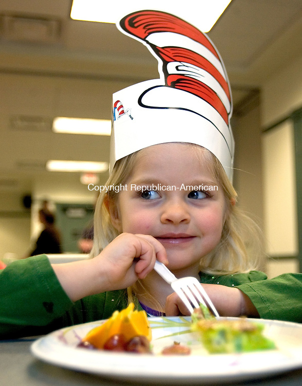 (CountryLife Only).SOUTHBURY, CT. 02 January 2012-030212SV06-Claudia Burrus, 4, of Southbury enjoys her breakfast during a Dr. Seuss green eggs and ham breakfast with stories and crafts at the library in Southbury Friday..Steven Valenti Republican-American