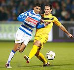 Nederland, Zwolle, 30 november 2012.Seizoen 2012-2013 .Eredivisie .PEC Zwolle-VVV Venlo.Youness Mokhtar (l.) van PEC Zwolle en Guus Joppen (r.) van VVV Venlo strijden om de bal.