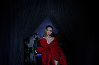 JOHANNESBURG, SOUTH AFRICA OCTOBER 29: A model walking for the Elle risen star designer label Nicholas Coutts waits backstage before a show at Mercedes Benz Africa fashion week Africa on October 29, 2014 held at Melrose Arch in Johannesburg, South Africa. Designers from all over Africa showed their best collections at the yearly event. (Photo by: Per-Anders Pettersson)