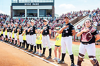 Softball team during national anthem.<br />  (photo by Beth Wynn / &copy; Mississippi State University)