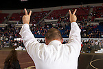 02/26/11--Oregon City wrestling head coach Roger Rolen raises his hands to signify his team's two wins; Jared Groner for his win over Barlow's John Wolfe in the 285 lb. weight division and Kyle Sether after defeating Newberg's Garrett Rider in the103 weight division in the 6A wrestling state championship at the Memorial Coliseum..Photo by Jaime Valdez........................................