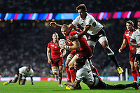 Mike Brown of England looks to reach the try-line. Rugby World Cup Pool A match between England and Fiji on September 18, 2015 at Twickenham Stadium in London, England. Photo by: Patrick Khachfe / Onside Images