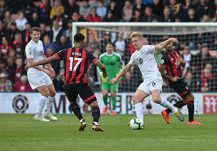 Burnley's Ben Mee (right) under pressure from Bournemouth's Joshua King (left)  <br /> <br /> Photographer David Horton/CameraSport<br /> <br /> The Premier League - Bournemouth v Burnley - Saturday 6th April 2019 - Vitality Stadium - Bournemouth<br /> <br /> World Copyright © 2019 CameraSport. All rights reserved. 43 Linden Ave. Countesthorpe. Leicester. England. LE8 5PG - Tel: +44 (0) 116 277 4147 - admin@camerasport.com - www.camerasport.com