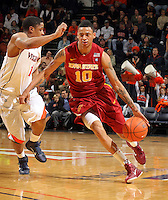 Dec. 30, 2010; Charlottesville, VA, USA; Iowa State Cyclones guard Diante Garrett (10) drives past Virginia Cavaliers guard Jontel Evans (1) during the game at the John Paul Jones Arena. Mandatory Credit: Andrew Shurtleff