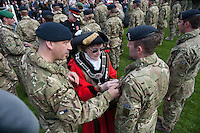 Wednesday 26 March 2014<br /> Pictured: Mayoress of St Davids Glenys James presents medals to the troops<br /> Re: 236 Signal Squadron ( part of 14 Signal regiment who are based at Cawdor Barracks in Brawdy Parade through the streets of  St.Davids Pembrokeshire led by Haverfordwest Air Training Corps Band and are then Presented with medals