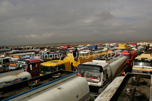 Zakho, Kurdistan.January 26, 2006..Turkish gas trucks wait for one day in a yard to return to Turkey from Kurdistan after delivering refined gas to Iraq. The wait to enter Kurdistan/Iraq from Turkey at this border is up to 30 days or 1 month. .
