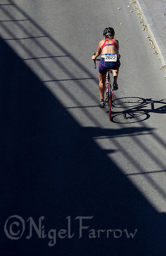 25 AUG 2013 - STOCKHOLM, SWE - A competitor cycles back to City Hall after making the Olympic distance turn at Gamla Stan during the Stockholm Triathlon in Stockholm, Sweden (PHOTO COPYRIGHT © 2013 NIGEL FARROW, ALL RIGHTS RESERVED)